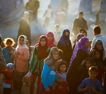 Displaced People Wait To Receive Food Supplies At A Food Distribution Point In Khazer Camp