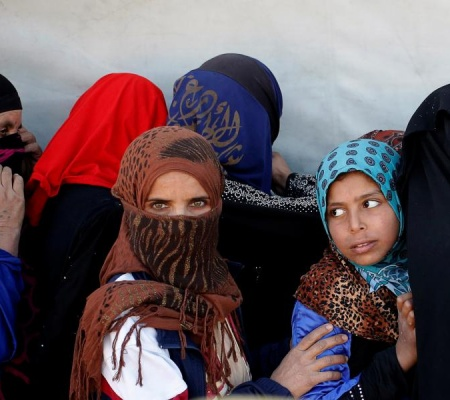 Women Wait For Food Donated By An Iraqi Government Organisation At The Outskirts Of Mosul